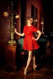 Fashion caucasian ballerina in red dress royalty free stock photos