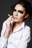 Fashion chic model smoking cigarette. Rock make-up Stock Photo