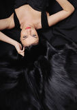 Fashion chic sensuality woman with long bright black hair Royalty Free Stock Photography