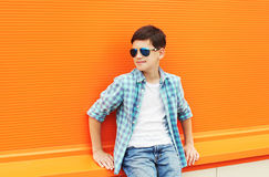 Fashion child boy wearing a sunglasses and shirt in city Royalty Free Stock Images