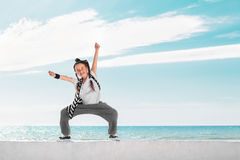Fashion child dancing over sky background. Royalty Free Stock Photo