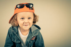 Fashion child. Happy boy model. Stylish little boy in baseball.  Handsome  kid  in the jeans jacket Stock Images