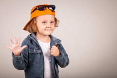 Fashion child. Happy boy model. Stylish little boy in baseball.  Handsome  kid  in the jeans jacket Stock Photography