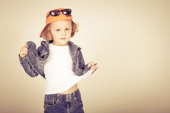 Fashion child. Happy boy model. Stylish little boy in baseball.  Handsome  kid  in the jeans jacket Royalty Free Stock Images