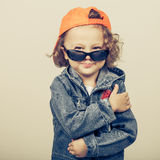 Fashion child. Happy boy model. Stylish little boy in baseball.  Handsome  kid  in the jeans jacket Royalty Free Stock Photos