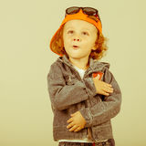 Fashion child. Happy boy model. Stylish little boy in baseball.  Handsome  kid  in the jeans jacket Royalty Free Stock Photo