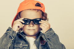 Fashion child. Happy boy model. Stylish little boy in baseball.  Handsome  kid  in the jeans jacket Stock Photos