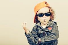 Fashion child. Happy boy model. Stylish little boy in baseball.  Handsome  kid  in the jeans jacket Stock Photo