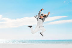 Fashion child jumping over sky background. Royalty Free Stock Photo