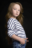 Fashion child model in jeans Stock Photos