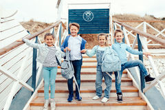 Fashion children on the sea shore Royalty Free Stock Photo