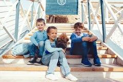 Fashion children on the sea shore Royalty Free Stock Photos