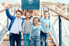 Fashion children on the sea shore Royalty Free Stock Photography