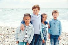 Fashion children on the sea shore Stock Photos