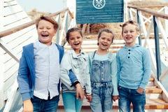 Fashion children on the sea shore Stock Photo