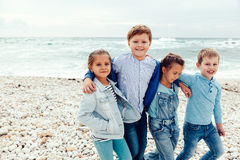 Fashion children on the sea shore Royalty Free Stock Images