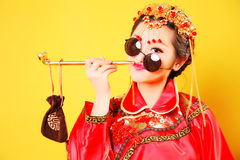 Fashion Chinese style —— human figures photography. Belle wearing Chinese ancient costume close-up on yellow background royalty free stock photography