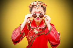 Fashion Chinese style —— human figures photography. Belle wearing Chinese ancient costume on yellow background stock images