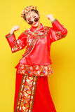 Fashion Chinese style —— human figures photography. Belle wearing Chinese ancient costume on yellow background stock photography
