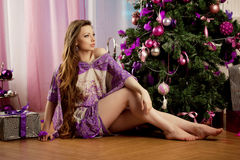 Fashion christmas woman in luxury interior Royalty Free Stock Images