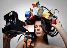 Fashion close-up portrait of beautiful young girl with cubes on head. Stock Photo