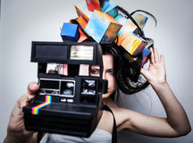Fashion close-up portrait of beautiful young girl with cubes on head. Stock Photos