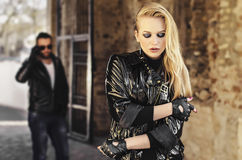 Fashion closeup picture of a woman  standing in front of his man. Fashion closeup picture of a women  standing in front of his men and looking away from the Royalty Free Stock Images