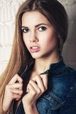 Fashion closeup portrait of beautiful blonde girl in jeans wear Stock Photography