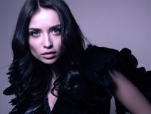 Fashion closeup portrait in cool tones. Young beautiful woman in black Royalty Free Stock Photo
