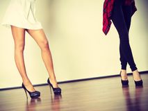 Two women legs presenting high heels royalty free stock images