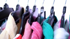 Fashion clothes on clothing rack ,colorful closet stock footage
