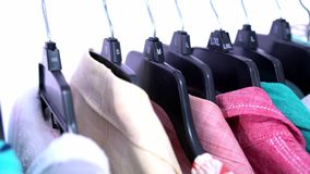Fashion clothes on clothing rack ,colorful closet stock video