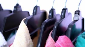 Fashion clothes on clothing rack ,colorful closet stock video footage