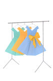 Fashion clothes: doll rack and hangers made of wire with ladies paper dresses Royalty Free Stock Photo