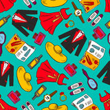 Fashion clothes seamless pattern background. Clothes seamless background. Vector wallpaper with pattern icons of man, woman wear, dress, suit, hat, shoes, mirror Stock Photography