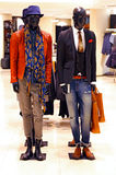 Fashion clothes store for men. Summer/spring fashion clothes for men on display in a store royalty free stock photos