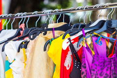 Fashion clothing on hangers. At the show Stock Photo