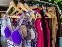 Fashion clothing on hangers Stock Images