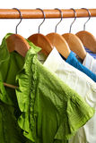 Fashion clothing on hangers at the show. Royalty Free Stock Photography