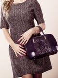 Chic woman with handbag. Stock Photography