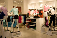 Fashion clothing store. With beautiful lighting and interiors Stock Photography
