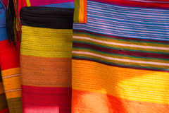 Fashion and colored rug background. Background of colored Ecuadorian textile at the market of Otavalo in Ecuador, 2015 stock photos