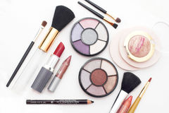 Fashion colors. Makeup brushes and colorful cosmetics Stock Photo