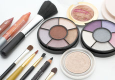 Fashion colors. Makeup brushes and colorful cosmetics Royalty Free Stock Photo