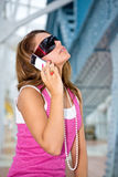 Fashion communication. Closeup portrait of brunette with mobile phone Royalty Free Stock Photo