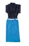 Fashion composition with blue tube skirt and polka dots blouse. Fashion composition with blue tube skirt, white leather belt and transparent polka dots blouse Royalty Free Stock Photos