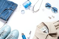Fashion concept flat lay with trench coat. Casual outfit top view frame. Copy space stock photo