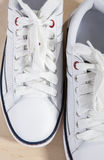 Fashion Concept and Ideas. Closeup of Pair of White Fashionable Trainers Stock Images