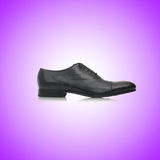 Fashion concept with male shoes against gradient Royalty Free Stock Photography