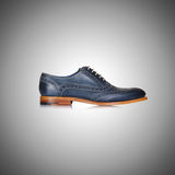 Fashion concept with male shoes against gradient Royalty Free Stock Photo